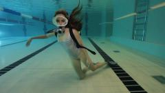 Female scuba diver with silver swimsuit Stock Footage
