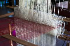 Vintage manual weaving loom with unfinished textile work Stock Photos