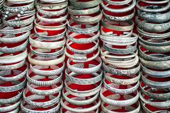 Cheap souvenir bangles at asian market. laos Stock Photos