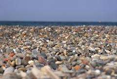 Background of a pebble beach Stock Photos