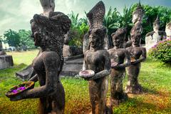 Stock Photo of mythology and religious statues at wat xieng khuan buddha park. vientiane, laos