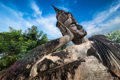 mythology and religious statues at wat xieng khuan buddha park. vientiane, laos - stock photo