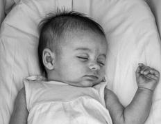 innocent face of a sleeping baby - stock photo