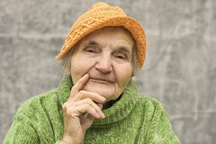 portrait of thoughtful elderly woman - stock photo