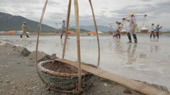 Empty bamboo baskets Workers in Background Stock Footage