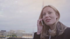 Young, attractive, businesswoman on a mobile phone - stock footage