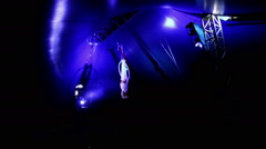 Woman acrobat performs a trick in circus can not see a face Stock Footage