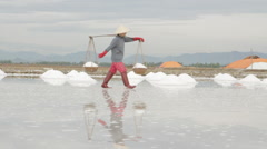 Workers Moving Back and Forth Transporting Salt Stock Footage