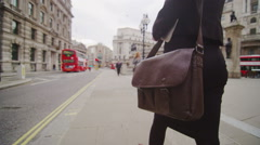 Business woman walking through the streets of London with briefcase Stock Footage