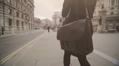 Business woman walking through the streets of London with briefcase - stock footage