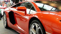 luxury fast car (exterior) - people on exhibition - Lamborghini - Aventador - stock footage