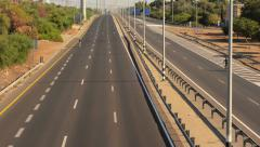 Two cyclists traveling in opposite directions on deserted highway - stock footage