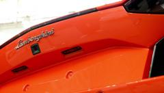Lamborghini - Aventador car (exterior) - back side - detail of logo Stock Footage