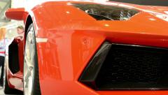 Luxury fast car (exterior) - people on exhibition - Lamborghini - Aventador Stock Footage