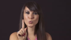 Cute young woman saying no with her finger: negative gesture, denial, refusal Stock Footage