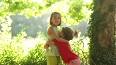 Young kids hugging, love, care, innocence - stock footage