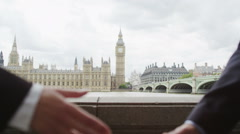 Businessman and Businesswoman shaking hands in London, UK Stock Footage