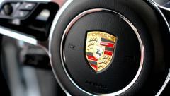 Detail of logo (wheel) - Porsche (interior SUV - Macan Turbo) Stock Footage