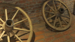 Pan view over old wooden cart wheels Stock Footage
