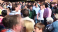 People walk by each other blurred and in time lapse Stock Footage