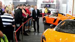 McLaren cars (exterior) - people on exhibition Stock Footage