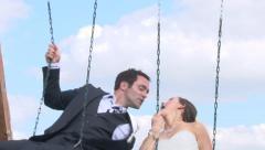 Kissing Wedding Couple on Swings Stock Footage