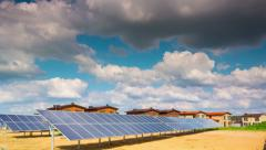 Solar panels and modern village, 4K time-lapse Stock Footage