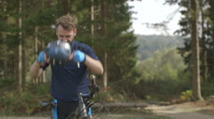 Man with bicycle Stock Footage