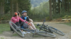 Couple relaxing with bicycles Stock Footage