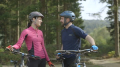 Couple resting with bicycles Stock Footage