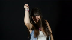 young sexy girl dancing on black background: brunette, 20s, disco music, moving - stock footage