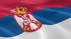 serbian flag in the wind - stock photo
