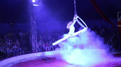 Woman acrobat performs a trick in circus Stock Footage