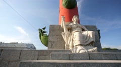 Seated marble figures decorate the base of Rostral columns on Vasilevsky Island. - stock footage