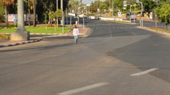 Young black man goes on deserted road Stock Footage