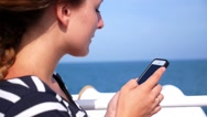 Stock Video Footage of Woman Using Mobile Phone Sailing on a Yacht.