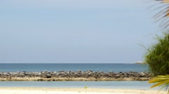 Sunny Beach and Calm Sea. Vacation and Happiness Concept. Stock Footage
