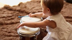 Beautiful girl playing the drums, slow motion HD Stock Footage