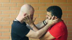 Two men fighting with hands on their faces: quarrel, fight, conflict. Slowmotion Stock Footage