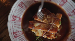 Forkful of poutine on plate w/ steam Stock Footage
