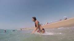 Slow motion woman jumping in the water in bikini Stock Footage
