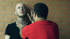 Two men fights putting their hands over faces and neck. Slowmotion Stock Footage