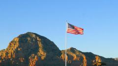American Flag with Red Rocks in the Evening Sun Stock Footage