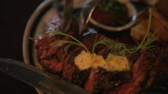 Close up of cutting into steak dish in restaurant Stock Footage