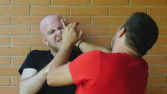 Men fighting against the wall: violence, fight, getting into fights. Slowmotion Stock Footage