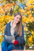 Attractive young woman enjoying an autumn day Stock Photos