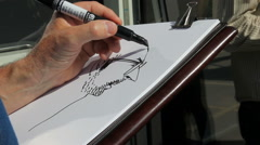Sketch Artist drawing a portrait with a black marker Stock Footage