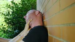 Men fighting against the wall: violence, fight, getting into fights Stock Footage