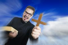 The priest showing cross and bible Stock Photos