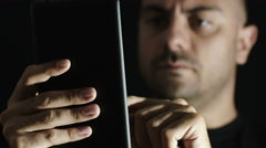 Young man is using phablet searching something on the web Stock Footage